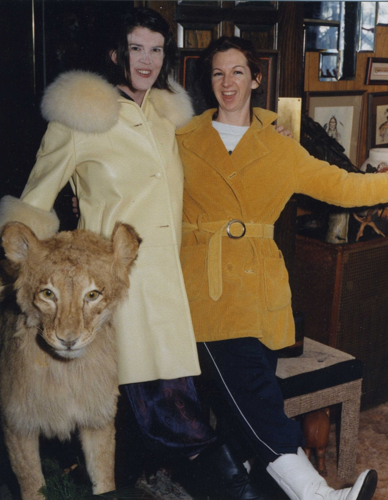 mae and meg in front of mabel (the stuffed lion from Africa)
