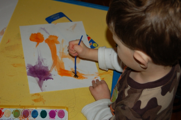 My son painting with watercolors
