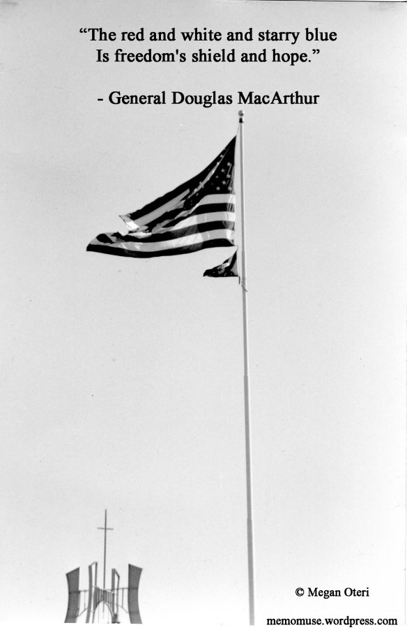 Faith and Freedom. A black and white photo of an American flag with a church steeple in the background