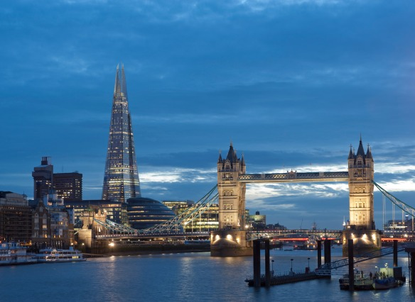 View of the Shard from across the Thames River with Tower Bridge in view.